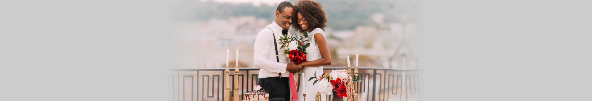 Charming black wedding couple holding handes on the terrace